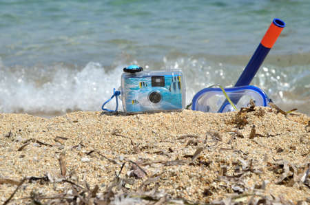 masque: Water camera, snorkeling masque and sea star with foamy wave in background