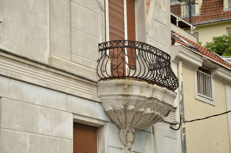 decorative balcony: Balcony with decorative iron fence of an old building