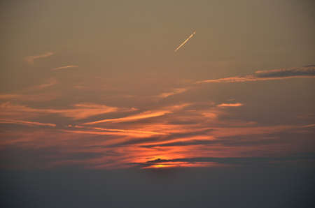 trace: Sunset sky with plane trace