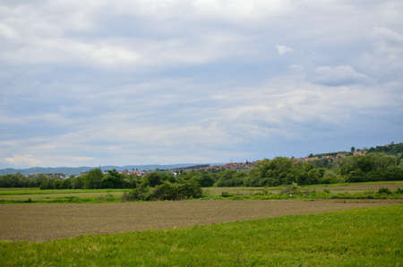 arable land: Plains and arable land under cloudy sky in spring