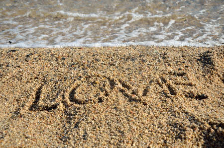 title emotions: Word LOVE written on golden beach sand Stock Photo