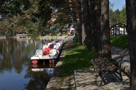 pedal: Pedal boats, parked in a row on Zlatibor lake. Stock Photo