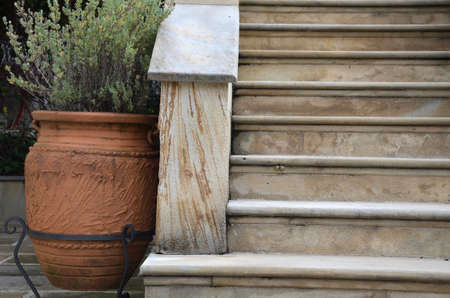 greek pot: Stone stairs and a Greek style large pot with garden plant