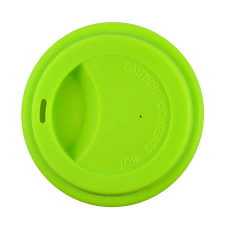 Container for coffee or hot drinks covered with its green lid, shot from bird's eye perspective and isolated on white
