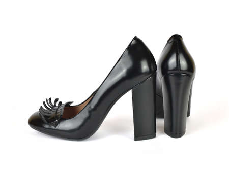 Black classic leather high heel loafer shoes on white
