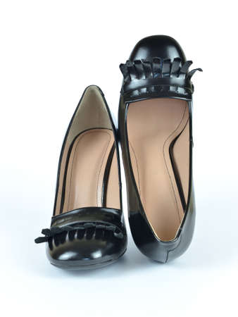 Black elegant shiny leather high heel loafer shoes on white
