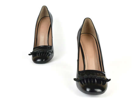 loafer: Pair of Black High Heel Loafer Shoes in a Step Pose