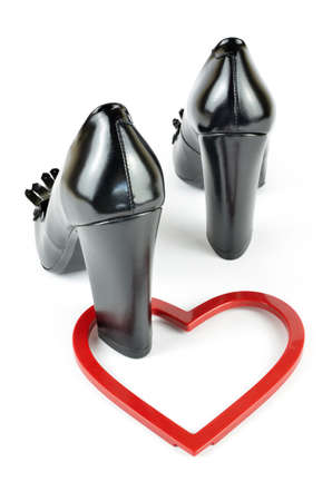 Black elegant leather high heel loafer shoes and heart figure on white