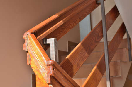 Close-up of wooden handrail in a hallway of a building