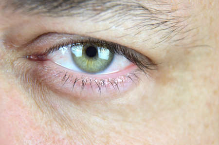 Close-up of a mans left eye showing anger Stock Photo
