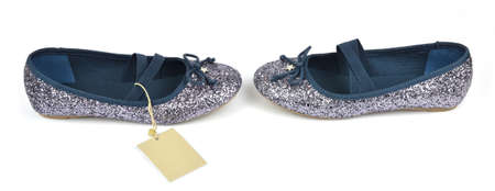 Shimmer silver blue ballerina flat shoes with crossed elastic drawstrings and a price tag on white Stock Photo