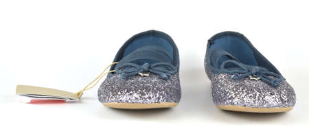 Comfortable shimmer silver blue ballerina flat shoes with a small bow and a rubber outsole on white background