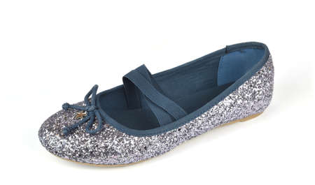 Shimmer silver blue ballerina flat shoe with a small bow and with crossed elastic drawstrings on white Stock Photo