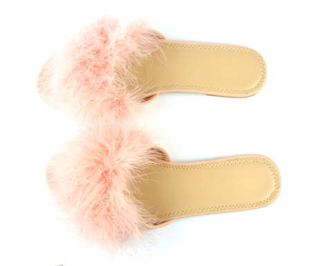 Pair of flat pink feather slippers isolated on white background