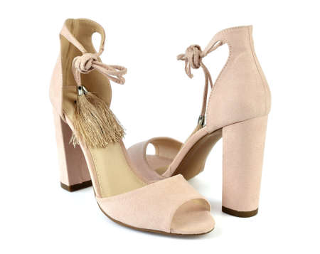 Nude look Roman style high-heeled sandals isolated on white background Stock Photo