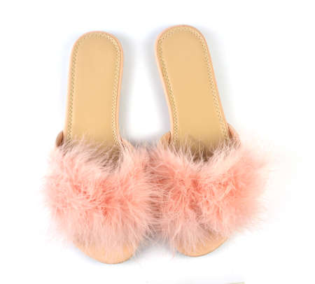Flat pink feather slippers on white background - top view