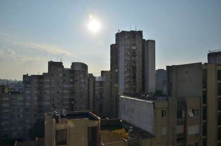 Sunrise over residential buildings in an urban city area Stock Photo