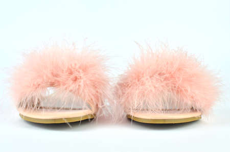Flat pink feather slippers on white background