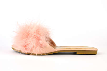 Flat pink feather slipper on white background