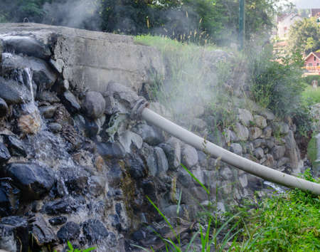 Brook of natural hot water and a pipe conductor, Josanicka Banja, Serbia 스톡 콘텐츠 - 118587931