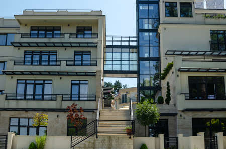 Modern real estate exterior and a dog on top of stairs 写真素材