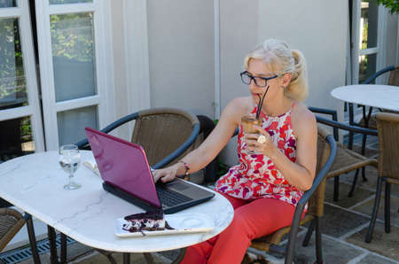 Woman working with technology outside an office