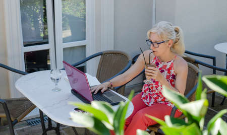 Woman working with technology out of office