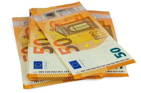 Bunch of fifty Euros banknotes set on a white background 写真素材