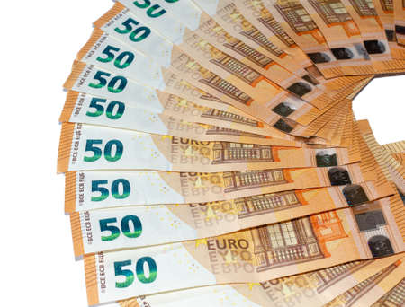 Bunch of fifty Euros banknotes on a white background 写真素材