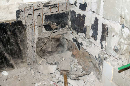 Hammer and construction wreck in a bathroom during renovation works