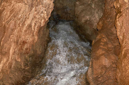 Stream in an ancient cave - Stopica cave, Zlatibor mountain - Serbia 스톡 콘텐츠