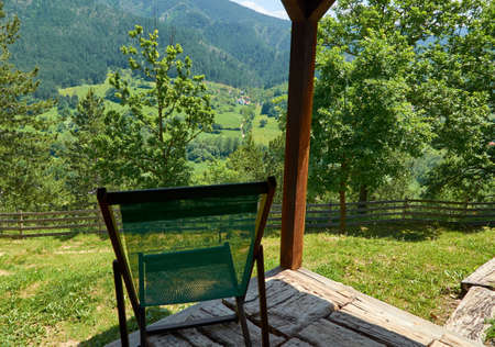 Lazy chair with a view to a picturesque landscape on a sunny day