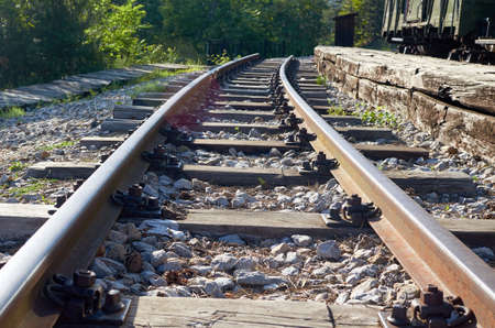 Railroad track with a part of a wagon on a next track on a sunny day 版權商用圖片