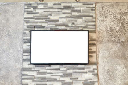 Flat TV set on a wall with blank white screen suitable for inserting picture or text