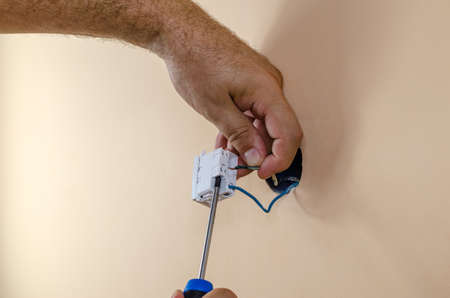 Connecting electric wires to modular switch with a screwdriver