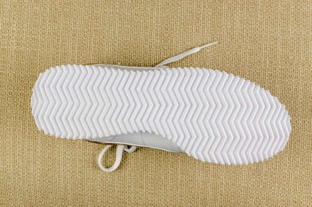White rubber sole of a white sport shoe Stock Photo
