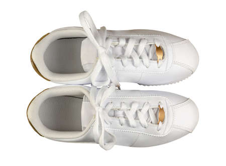 Pair of white leather sport shoes, isolated on white background, shot from above