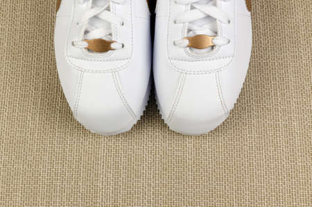 Front part of white sport shoes, shot from above