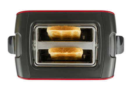 Toaster with two pieces of baked bread, isolated on white - shot from above