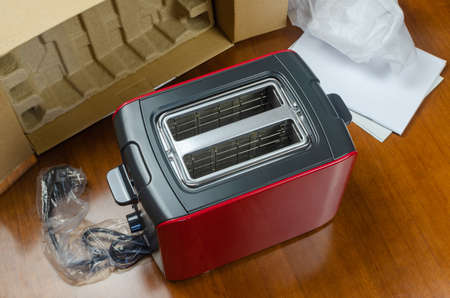 Brand new black-red toaster just unpacked - shot partly from above
