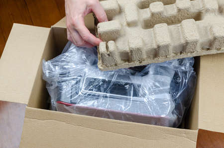 Woman's hands while unpacking a brand new toaster