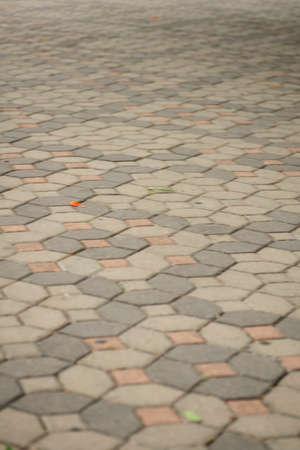 strangers: Walking along a cobblestone street