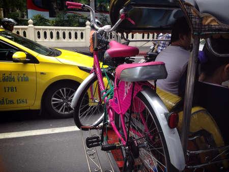 tuk: Tuk Tuk with bike in bangkok street Stock Photo