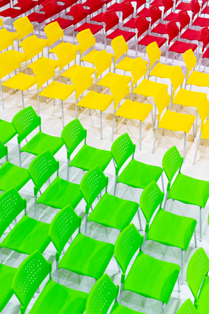 Rows of bright color chairs arranged in meeting room ready to sit. high angle shoot, top view photo.