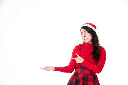 Young Asian woman showing product with open hand palm Isolated on white background studio shot. Stock Photo