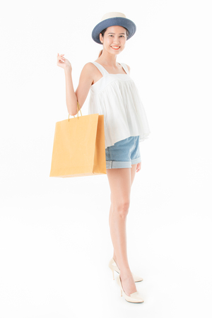 Portrait of young Asian woman happy smiling with shopping bag, isolated on white background. Stock Photo