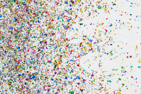 colorful, glossy glitter and confetti spread on white background for festive, greeting atmosphere. pattern design artwork for banner or decorations