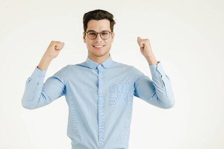 Young hipster office man feeling very happy excited fun, portrait shot isolated on white background. Standard-Bild