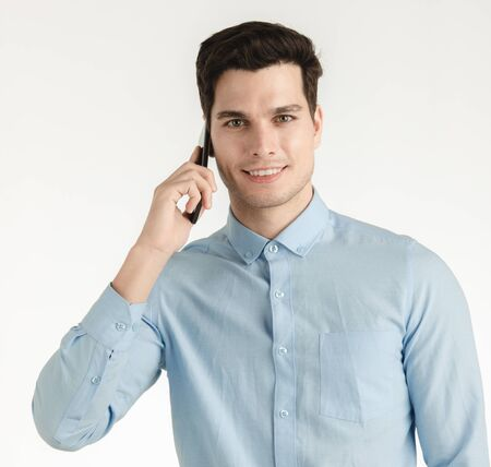 Young hipster man, confident happy smile talking on phone for business work, portrait isolated on white background. Imagens