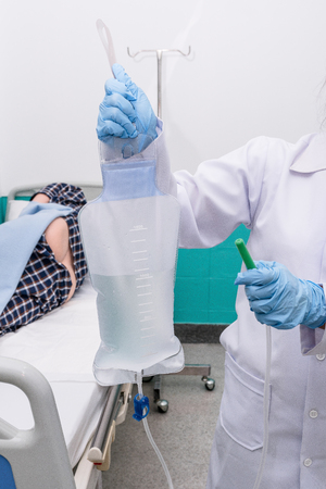 rectum cancer: Doctor gives her patient for enema to resolve constipation problem.